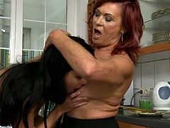 This mature woman with big tits is a seasoned pro when it comes to pleasing girls. She licks her lesbian friend's pussy greedily like a true cunt licker.