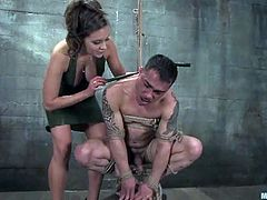 Submissive guy gets tied up and suspended by his mistress. Then she whips and chokes him. Later on she rides his dick like wild animal.