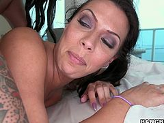 Two sexy dark-haired chicks Christy Mack and Rachel Starr are having some good time together. They oil each other's bodies and rub their butts against each other and then share some lucky stud's prick.