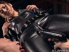 This spy gets captured and her perverted captures threaten her with guns and lick her leather jumpsuit. They pull open her suit to see her tits which makes them so horny. They poke her nipples with the barrels of their guns.