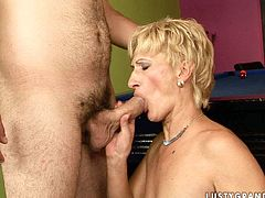 Sassy granny seduced young stud for sex. She gave him a head so he had a hard boner. Then she bent over the table getting rammed hard in her twat doggy style.