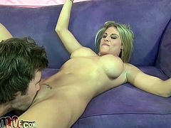 Horny fucker is lies on the sofa while that sexy and horny blonde hoe is sucking his hard cock, she enjoys doing that and prepares him for cock ride.