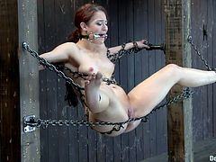 Hot Cheyenne has a sexy body but she's kept in chains by her executor. The guy has some very special plans with her and he's about to apply them. She stays there completely immobilized and mouth gagged as he begins by pinching her feet and then rubs her pussy with a vibrator. Does she enjoy it?