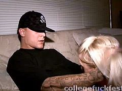 Aroused tattooed dude makes out with a foxy blond chic during an insane student party. He lets her give a head to his penis before she rides him in cowgirl style later switching to missionary pose right in the room where other folks party.