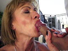Granny is going to seduce this dude. Well, she does it and now she is on her knees, sucking that thick cock! She is just fucking crazy and lusty!