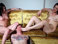 Andy San Dimas and Kimberly Kane lick each others feet lying on a sofa. Then they also give a footjob and get their pussies licked.