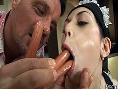 Frankfurter stuffed in her mouth and butt hole.Watch this hot food fetish video with lots of nasty action,and she takes them in her tight anal hole too.
