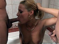 Lustful blonde mommy is hell seductive woman with stunning body shape. She takes off her tempting black dress exposing her beauty. Then she kneels down sucking dripping cocks switching from one to another. Then she gets penetrated in her clam from behind.
