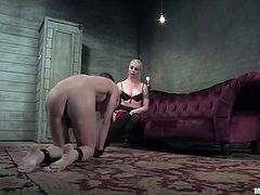 Lorelei Lee is gonna punish naughty boy called Nomad. She binds the dude and attaches clothes pegs to his body and then beats his butt with a stick and plays with his hard cock.