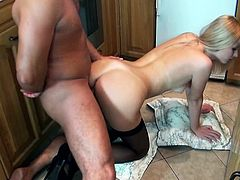 Blonde whore Charlyse with stockings and natural tits fucked doggystyle in the kitchen by the neighbor. She gets cum in mouth from him.
