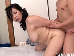 A chubby Asian MILF called Yuuka Kuremach is going to blowjob this guy and then get fucked hard in different positions.