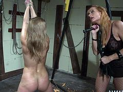 Cruel mistress dominates her sex slave viciously in her dungeon, whipping her ass hard until it turns scarlet red. Press play and get ready for the hottest BDSM sex video ever!