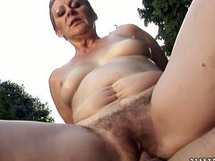 Slack brunette mature lies on the bench outdoor while an aroused daddy eats her bearded pussy with pleasure before she proceeds to riding him reverse cowgirl style.
