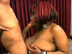 Kinky ebony milf with red hair pleases some guy with a hot blowjob. Then she sits down on his wang and they bang in cowgirl and other positions.