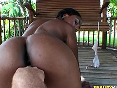 This black whore gets naked and bend over to give a blowjob to this guy before mounting his meaty pole like a cowgirl all the way to pussy paradise.