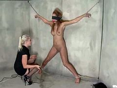 Angel Cummings gets bound by blonde dominatrix Lorelei Le in a basement. Lee attaches wires to Angel's ass and then fucks her hot pussy doggy style with a strapon.