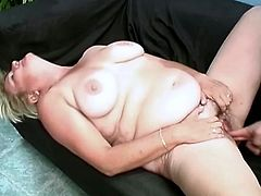 Blonde mature Sussana with big tits and chubby body is fingered in her wet pussy and then she gets cum in mouth from guy who fingered her.