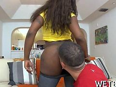 Cute ebony is riding on studs cock until he surrenders