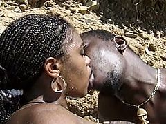 After sucking her man's hard rod of black meat under the sun at the beach, this intense ebony belle gets he hairy black pussy rammed into a superbly hot orgasm.