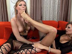 Lesbians are using their soft feet to stimulate their wet pussies in oral