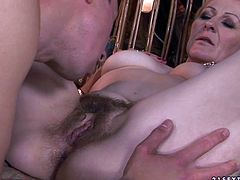 Worn out short haired blond mature squats down in front of a kinky dude that sits in the swing to oral fuck his strain dick before she replaces him in the swing to welcome tongue fuck of her bearded pussy in steamy sex video by 21 Sextury.