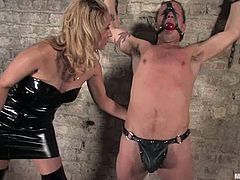 Billyis having fun with dominant hottie Isis Love in a basement. Isis whips the stud mercilessly and humiliates him and then drills his tight butt with a strapon.