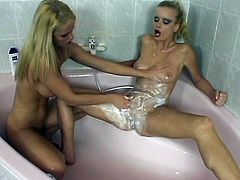 Two cute blondes Miu Lee and Victoria Slim are having lesbian fun in the bathroom. They stroke each other's wet soapy bodies and then explore each other's nice pussies.