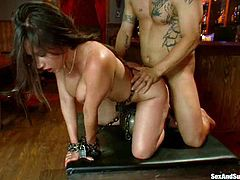Superb brunette with big boobs gets tied up and also toyed with a vibrator. After that she blows a dick and gets fucked hard.