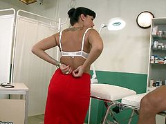 This hot tanned brunette doctor is called Ava Dalush and she's taking care of a patient with a big cock, big enough to make her undress to be fucked hard.