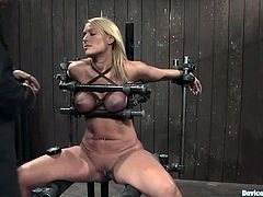 Awesome blonde chick Mellanie Monroe is getting naughty with some guy in a basement. She lets him put her into irons and gets her boobs pressed till they turn blue.