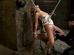 This amazingly hot blond angel Mae Meyers is getting abused in a very rough way. He puts a rope on her neck and suspends her a bit.