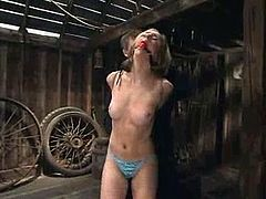 That slave's name is Kelly Wells and she loves being in pain! So honey lives in the barn and this dude tortures her frequently!
