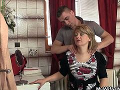 This slutty mom accepted a massage from her son-in-law, which has quickly turned into pussy pounding. While she was riding his cock, her daughter caught them.