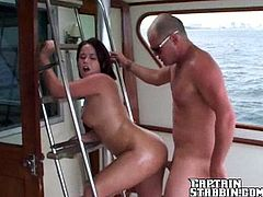 Hot brunette girl gives a blowjob and then gets her vagina licked on a boat. After that she gets fucked jizzed on her tits.