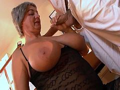 This dirty granny is horny as hell and needs cock desperately. Young guy was just there for her to destroy her wet vagina in all known poses.He slide his weiner and fuck her in few poses before he releases his sperms on those big tits
