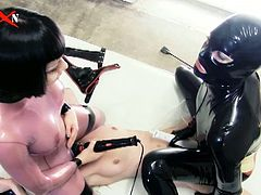 Two horny dominating babes in seductive latex costumes spanks poor blonde Elvira,They fucked her hard with huge toys and strapon, It looks extremely hot and sexy. so check it out!
