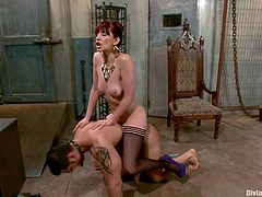 Redhead mistress Maitresse Madeline is playing dirty games with Marcus Ruhl. She rubs his dick and attaches clothes pegs to his scrotum and then humiliates him in many ways.