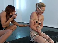 Tied up blonde girl gets her tits wired by her brunette mistress. Later on Bailey gets her pussy and ass toyed at the same time.