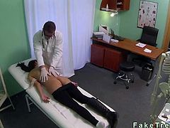 Stressed brunette hottie came to doctor beacuse she had headaches and he strips her off and massages her gorgeous body before fucks her pussy on examining table
