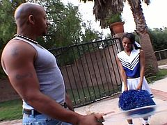 Watch a sexy ebony cheerleader lifting her skirt and getting her cunt rammed deep and hard into a hell of an orgasm by a beefy stud in this hardcore video.