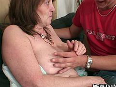 This young stud was already horny when his wife's mom arrived. She took a shower and she was only wearing a towel when he approached her. He fucked her old cunt until wife caught them.