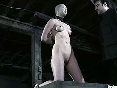 Hot redhead slut gets tied up and whipped. She also gets gagged with a ball. Later on she also gets choked and toyed.