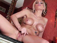 Lacey Foxx with huge hooters and smooth beaver opens her legs to fuck herself with dildo