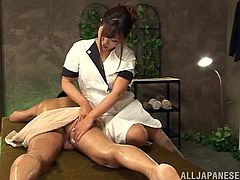Beautiful japanese slut Satou Haruka with natural tits and stocking massaging a horny guy then starts to ride his cock in the massage room.