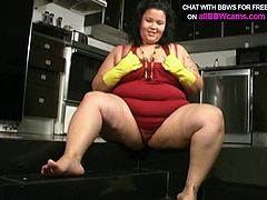 Sassy whore with huge boobs and fat ass washes dishes in the kitchen wearing rubber gloves. She starts masturbating passionately when she finishes with dishes. But she won't take off the gloves.