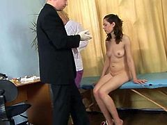Check out this innocent brunette teenie spreading legs wide for two horny doctors. They want to check up her tight pussy and she loved every second of this special examination!