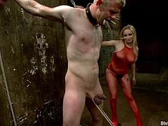 Sexy Aiden Starr dominates Cliff Adams. She tortures his dick and balls with ropes. Then she toys him in the ass with a strap-on.