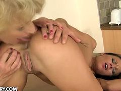 A slender brunette babe has some sexy fun with a fat blonde granny. She feeds her with her bald pussy and the old woman also licks her ass hole before fingering her.