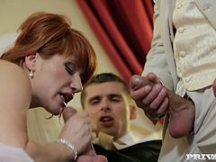 Cheating redhead bride Lucy eagerly blows best man's massive dick before wedding. Her future husband catches her and joins the action!