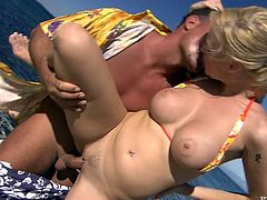 Slutty blonde is having fun with some dude on a beach. She favours the stud with an awesome blowjob and then they have anal sex in the reverse cowgirl and other positions.